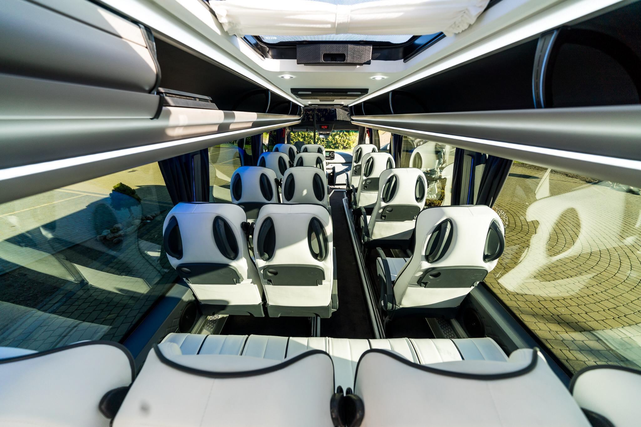 inside picture vip sprinter minibus white leather seats